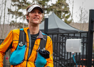 Andrew Broadmoore All Smiles Finishing the 12K - Photo Credit Mike Wheeler